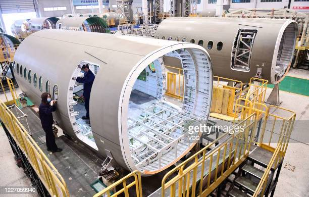 Employees manufacture components of Airbus A220 aircraft at a workshop of AVIC SAC Commercial Aircraft Company Limited on May 25, 2020 in Shenyang,...