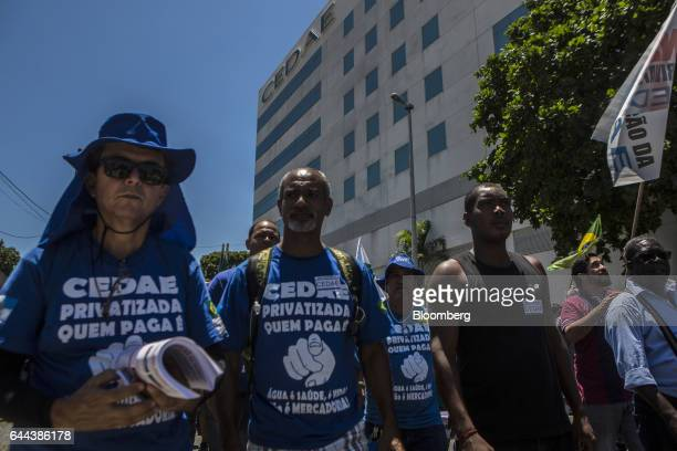 Employees march towards City Hall during a protest against the privatization of the State's water and sewage utility outside Cia Esadual de Aguas e...