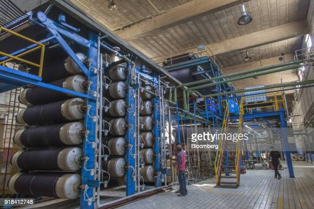 Employees monitor machinery in the dying plant at the Artistic Denim Mills Ltd factory in Karachi Pakistan on Tuesday Feb 6 2018 Pakistans...
