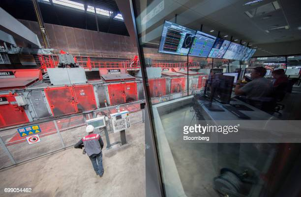 Employees monitor screens inside the control center at the Voestalpine Wire Rod Austria GmbH plant in Sankt PeterFreienstein Austria on Tuesday May...