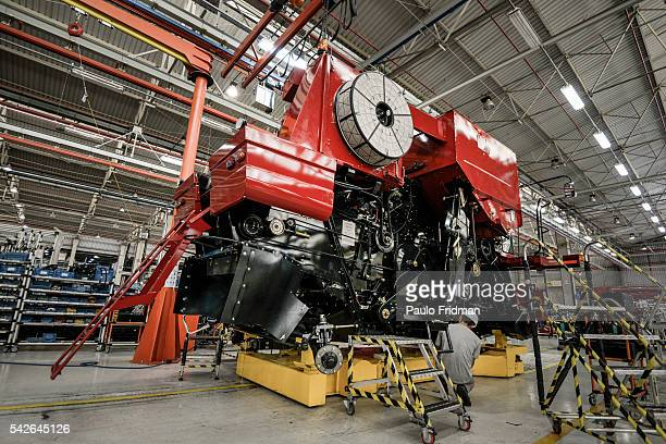 Employees mount aa grain combine At CASE Combines assembly line Sorocaba Brazil on Wednesday September 18th 2013