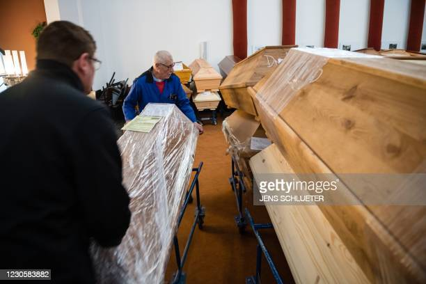 Employees move coffins through the mourning hall before cremation at the crematorium in Meissen, eastern Germany on January 13 during the ongoing...