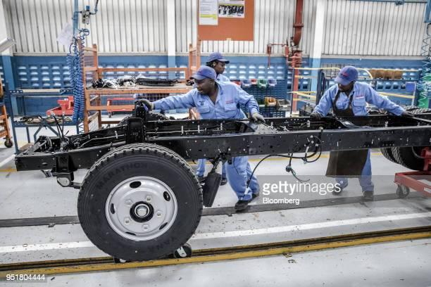 Employees move the chassis of an Isuzu truck on the assembly line inside the Isuzu East Africa Ltd plant in Nairobi Kenya on Thursday April 26 2018...