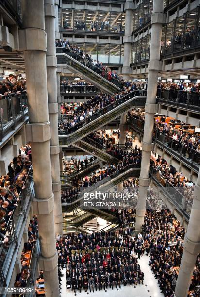 Employees observe a minute's silence in commemoration of Remembrance Day inside Lloyd's of London in the city of London on November 9 2018 November...