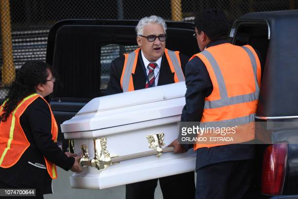 Employees of a funeral home load into a hearse a coffin with the repatriated remains of sevenyearold Guatemalan migrant girl Jakelin Caal Maquin who...