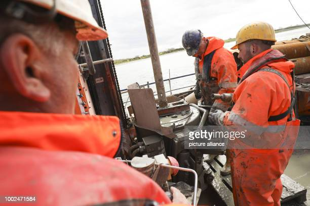 Employees of a specialised company work on a drilling platform in the Fehmarn Sound off Fehmarn island Germany 08 May 2017 Under contract from...