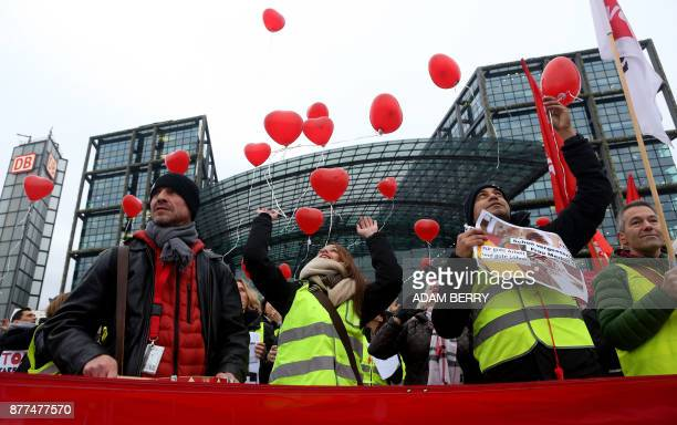 Employees of bankrupt airline Air Berlin release balloons during a demonstration against job losses and uncertainty over their fate under new owners...