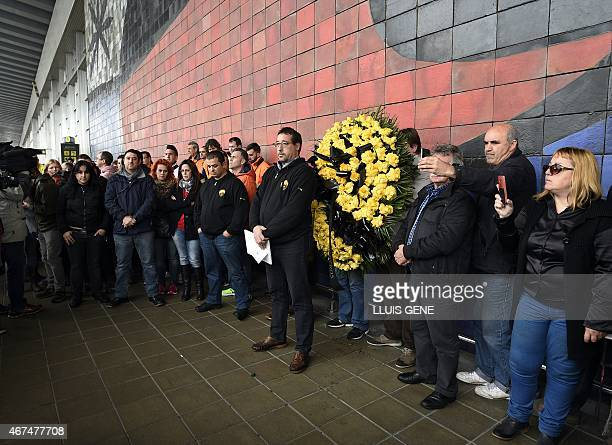 Employees of Barcelona's El Prat airport observe a minute of silence at noon to honour the victims of the crash of an Airbus A320, in El Prat de...