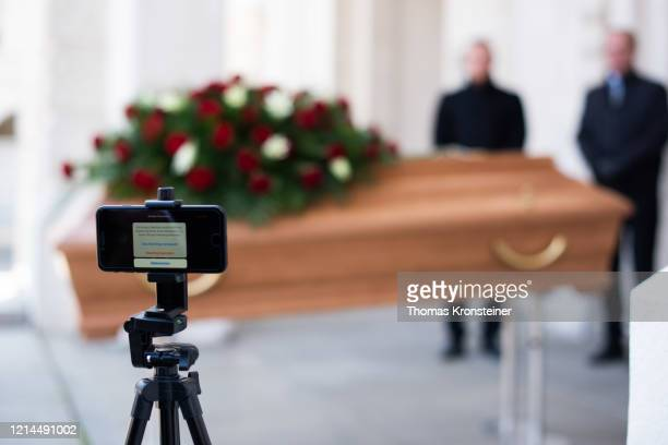 Employees of Bestattung Himmelblau undertakers rehearse the livestreaming of an upcoming funeral on March 24, 2020 in Vienna, Austria. Because the...