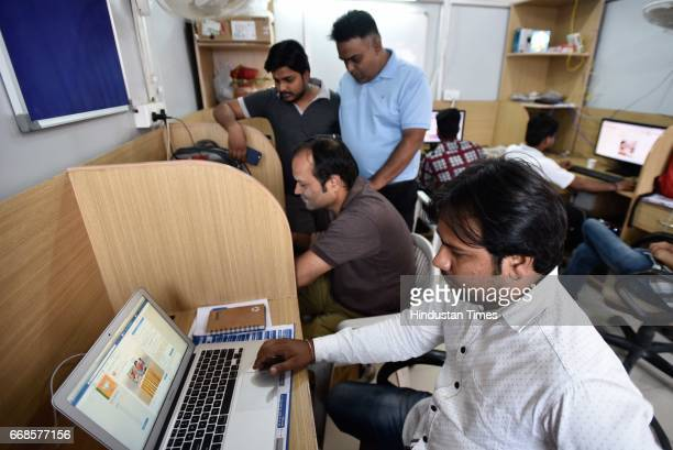 Employees of BJP work at the IT cell at BJP office on April 14 2017 in New Delhi India