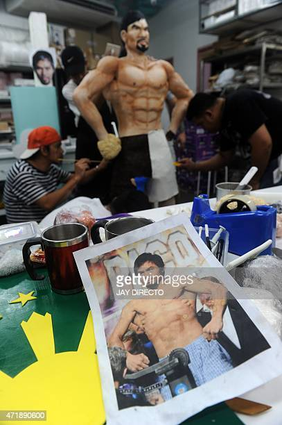 Employees of Bunny Baker Cafe decorate a lifesize 70 pound cake worth 4000 USD in the image of Philippine boxer Manny Pacquiao at the bake shop in...