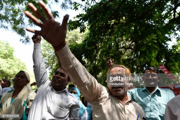 Employees of Central Public Works Department shouting slogans against government during May Day protests outside Nirman Bhawan on May 1 2017 in New...