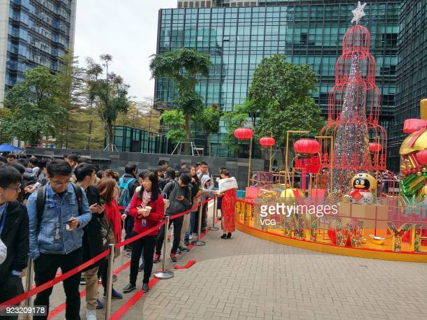 Employees of Chinese Internet giant Tencent queue up to get red envelops from Tencent Chairman and CEO Pony Ma Huateng at the headquarters of Tencent...