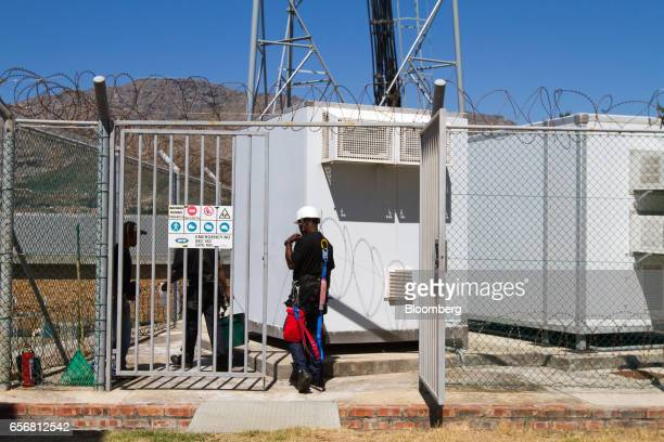 Employees of CJA Telecoms perform contract maintenance work at the base station of an MTN Group Ltd cellular phone mast in Cape Town South Africa on...