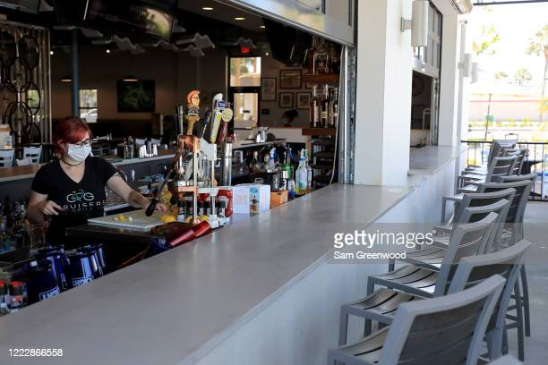 Employees of Cruisers Grill prepare for customers as the state of Florida enters phase one of the plan to reopen the state on May 04 2020 in...