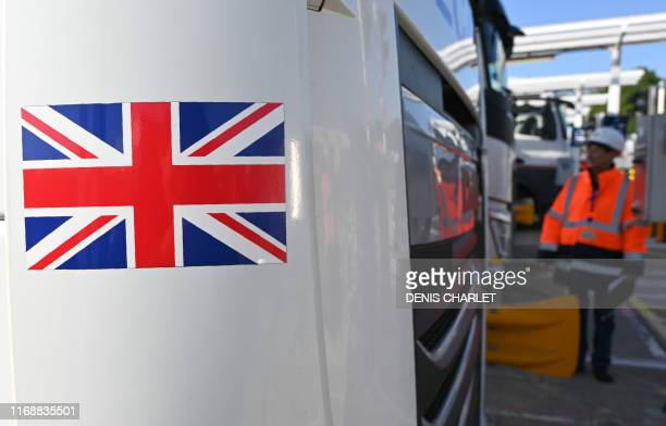 Employees of Eurotunnel check a British truck on its way to France during a day of test in case of Brexit at the entrance of the Channel tunnel in...