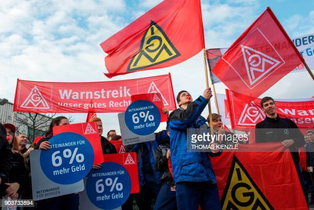 Employees of EvoBus a subsidiary company of Daimler AG participate in a warning strike called by the country's largest union the IGMetall in Mannheim...
