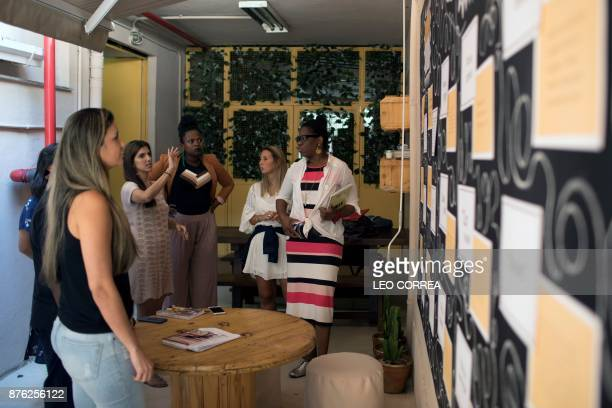 Employees of fashion brand Maria Filo talk about a mural developed with the support of the antiracism group ID_BR in Rio de Janeiro Brazil on...