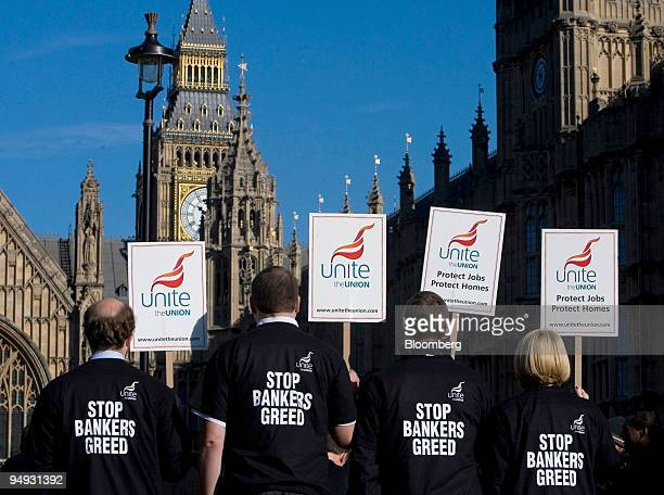 Employees of financial services companies and members of the Unite union protest The Bank of England said the world economic downturn turbulence in...