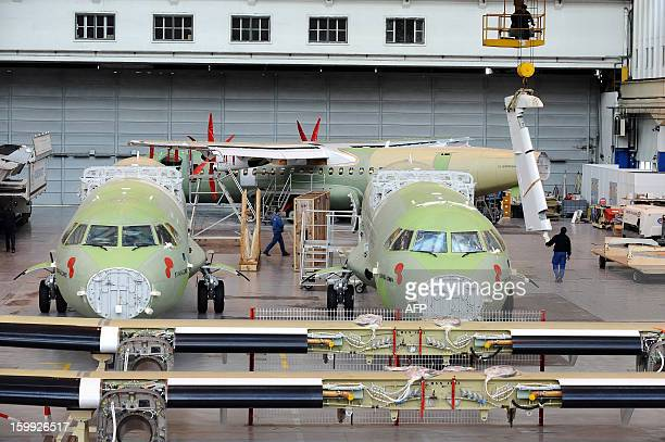 Employees of Franco-Italian aeronautics manufacturer ATR work on an assembly line on January 23, 2013 at the Toulouse factory. ATR registered for the...