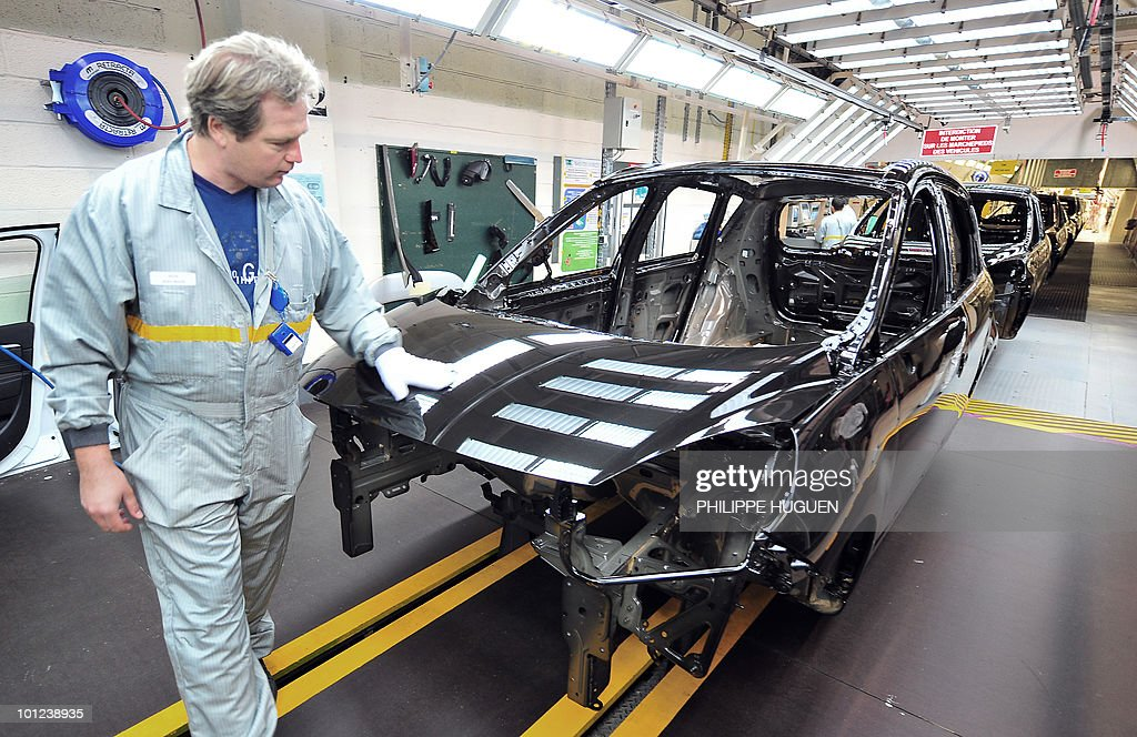 Employees of French carmaker Renault are at work at the painting department of a plant on May 25, 2010 in Douai, northern France.