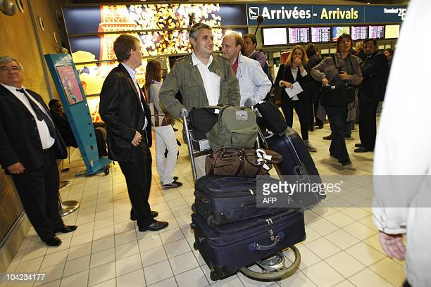 Employees of French company Areva arrive at the Roissy Charles de Gaulle airport outside Paris on September 18 2010 French companies Areva et Vinci...