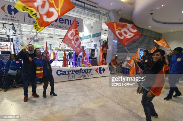 Employees of French multinational retailer Carrefour supermarket stage a strike to protest against the threat of job cuts and their working...