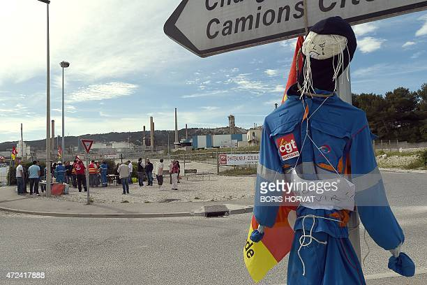 Employees of French oil giant Total's La Mede refinery gather near the refinery on May 7 2015 in ChateauneuflesMartigues southern France as members...