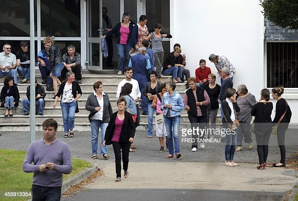 Employees of French poultry export firm TillySabco wait on September 22 2014 in Guerlesquin western France within a company's works council about a...