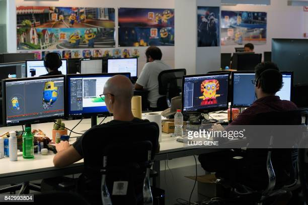 Employees of French video game developer Gameloft work on their computers during a visit to the company's studios of Barcelona on September 5, 2017.