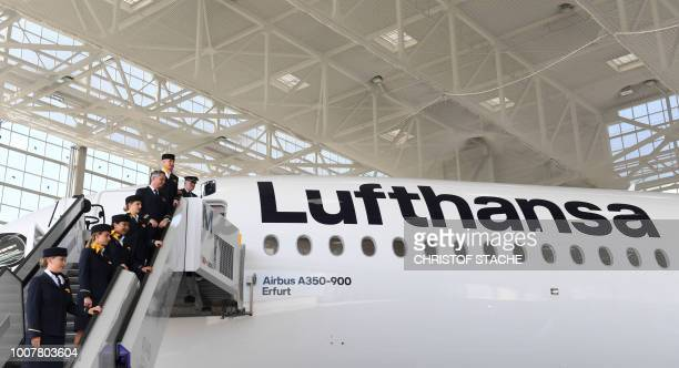 Employees of German airline Lufthansa attend a naming ceremony of the tenth Lufthansa Airbus A350900 on July 30 2018 at the FranzJosefStrauss airport...