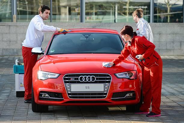 Employees Of German Car Maker Audi Polish On An Audi S Car Prior - Audi car maker