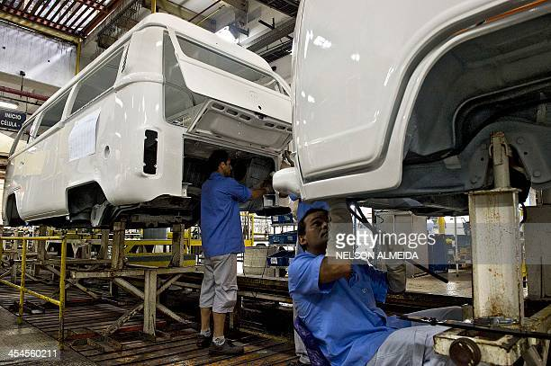 Employees of German carmaker Volkswagen work on an assembly line of Kombi cars at the company's plant in Sao Bernardo do Campo southern of Sao Paulo...