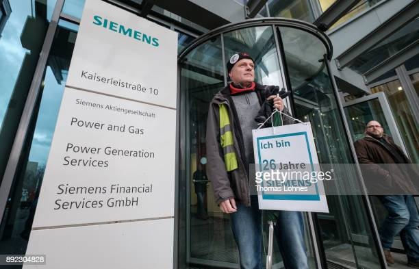 Employees of German engineering giant Siemens leave the local facility for a demonstration on December 14 2017 in Offenbach Germany Siemens announced...