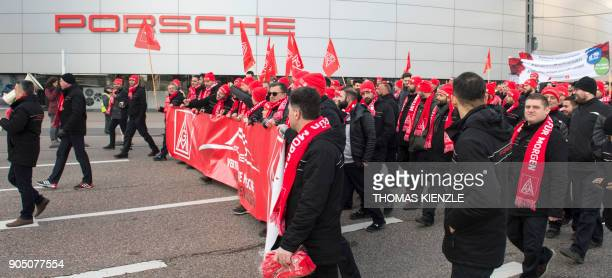Employees of German luxury car maker Porsche demonstre as part of a warning strike on January 15 2018 in Stuttgart southwestern Germany Strikes...