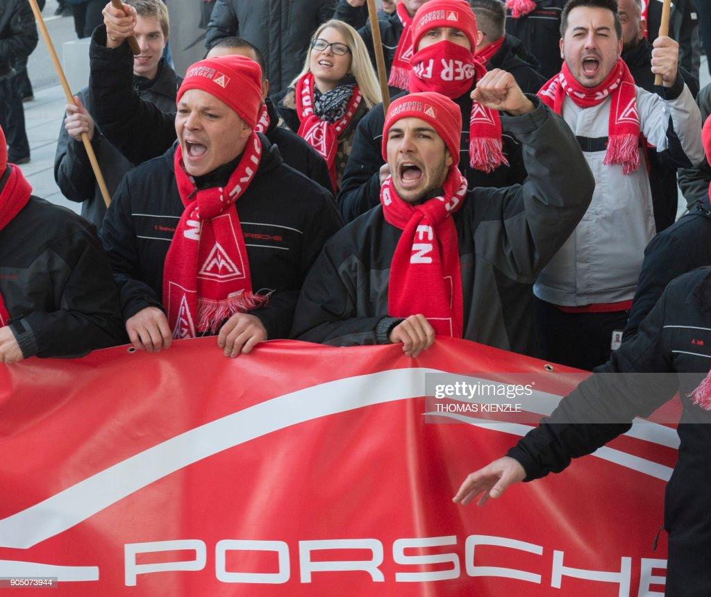 Metalworkers of IG Metall union demonstrate strike outside the plant of luxury carmaker Porsche in Stuttgart Zuffenhausen