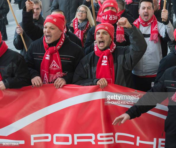 Employees of German luxury car maker Porsche shout slogans during a demonstration as part of a warning strike on January 15 2018 in Stuttgart...