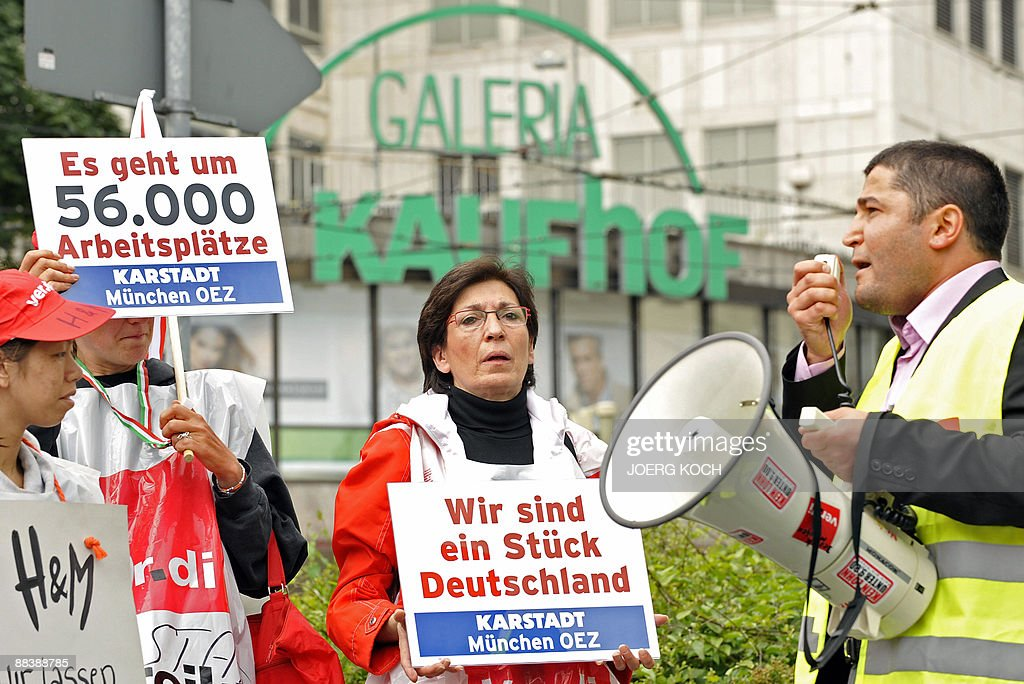 Employees Of German Retailers Karstadt And Kaufhof Hold Banners Reading  U0027Itu0027s A Question Of 56,000