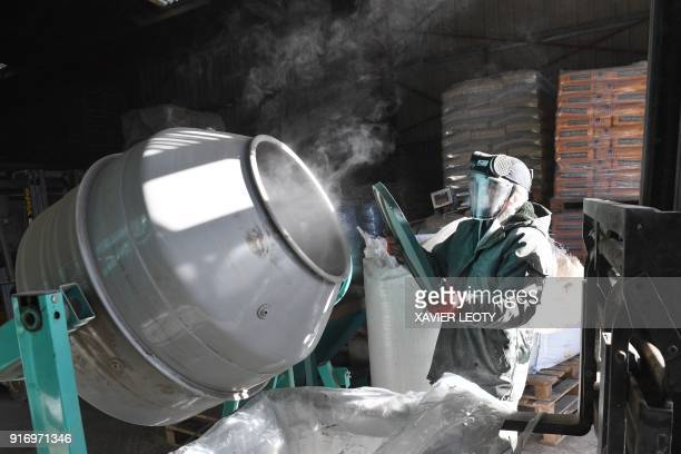 Employees of Getade Environnement company prepare herbal agricultural substances in BussacForet southwestern France on January 26 2018 Getade...