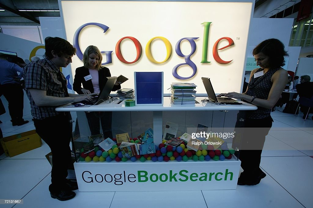 Employees of Google stand at the company's booth at the Frankfurt book fair on October 8, 2006 in Frankfurt, Germany. On Monday October 7 Google, the biggest force in search and Internet advertising bought YouTube, a company offering online video for 1.5 billion euros in stock.