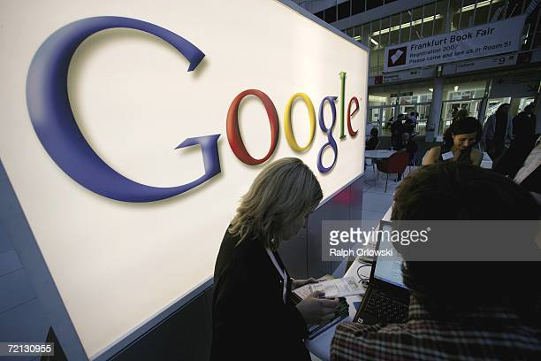 Employees of Google stand in front of the company's logo at Frankfurt book fair on October 8 2006 in Frankfurt Germany On Monday October 7 Google the...