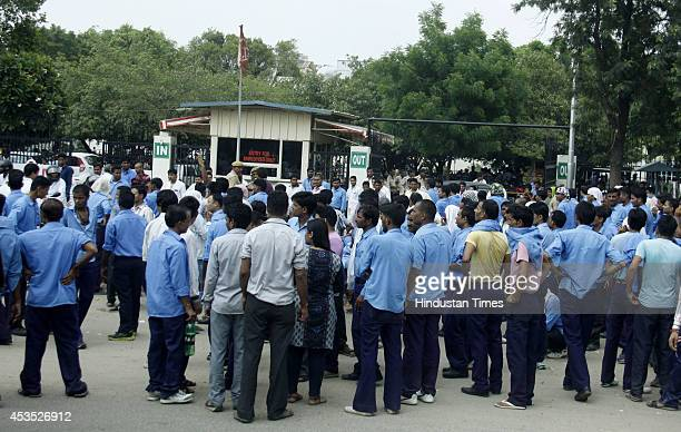Employees of Hero MotoCorp company protest outside gate on August 12 2014 in Gurgaon India The workers are protesting the alleged decision by Hero...