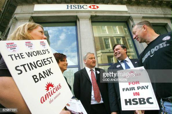 Employees of HSBC bank man a picket line outside the bank's Oxford