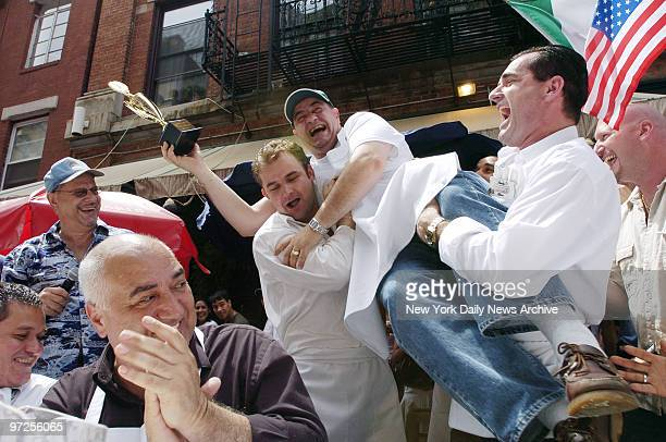 Employees of Il Cortile restaurant hoist their coworker waiter Fabrizio Rinaldi into the air as they celebrate his victory in the Third Annual Little...
