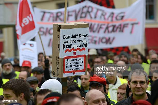 Employees of internet retail giant Amazon hold up posters reading 'Dear Jeff Bezos we are verdi Call us Stop the pressure the short term contracts at...