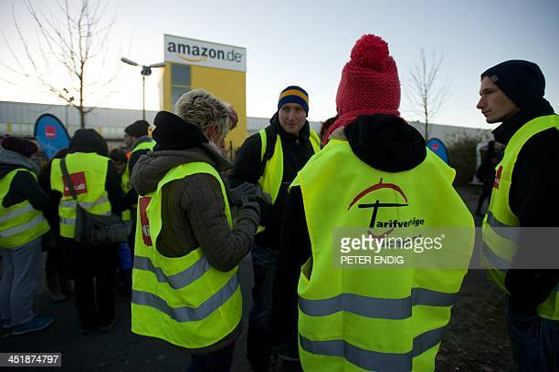 Employees of internet retail giant Amazon stage a strike in front of the company's logistics center in Leipzig eastern Germany on November 25 2013...