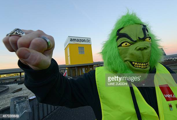 Employees of internet retail giant Amazon stage a strike in front of the company's logistics center in Bad Hersfeld central Germany on December 16...