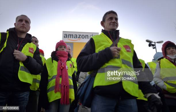 Employees of internet retail giant Amazon stage a strike in front of the company's logistics center in Leipzig eastern Germany on December 16 during...