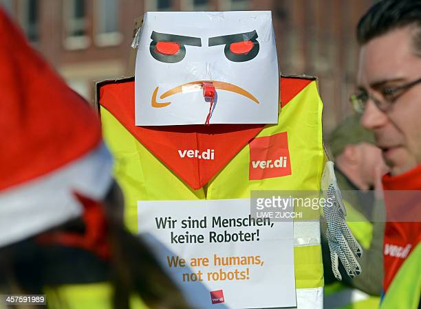 Employees of internet retail giant Amazon stage a strike in front of the company's logistics center in Bad Hersfeld central Germany on December 18...