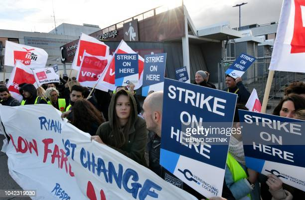 Employees of Irish airline Ryanair stage a strike on September 28 2018 at the Schoenefeld airport near Berlin northeastern Germany Ryanair cancelled...